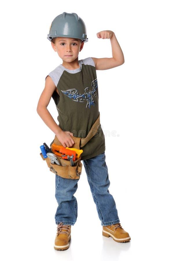 De jonge Jongen kleedde zich als Bouwvakker stock fotografie