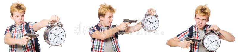 De jonge jongen met alarm-klok en pistool royalty-vrije stock afbeelding