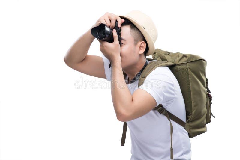 De jonge knappe reiziger neemt een beeld stock foto's