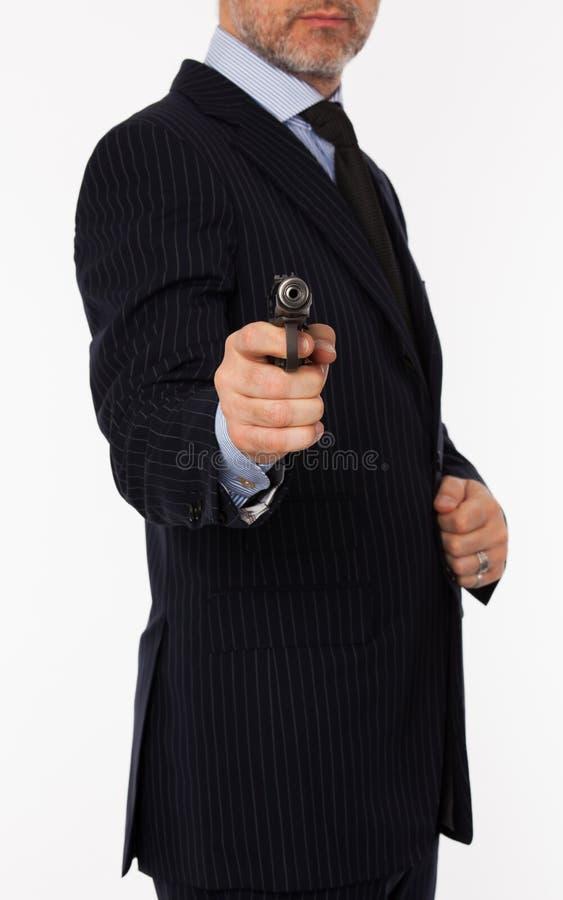 De jonge man met een pistool stock afbeeldingen