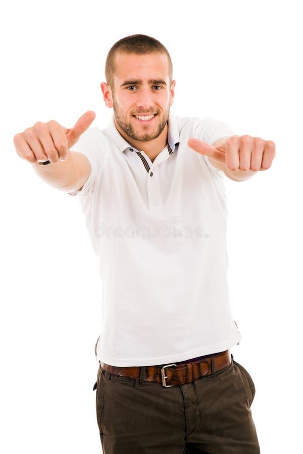 de jonge mens beduimelt omhoog stock foto