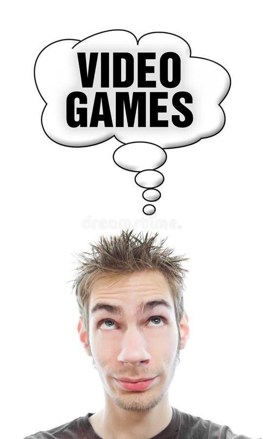 De jonge mens denkt over Videospelletjes royalty-vrije stock fotografie