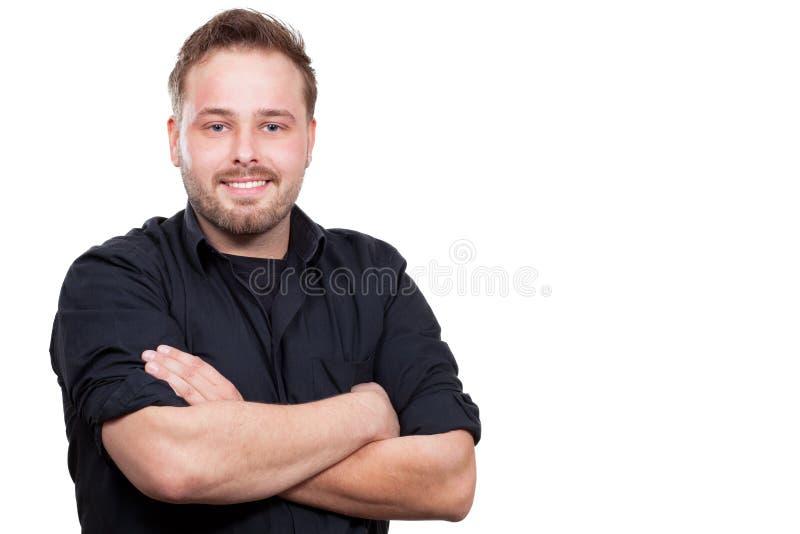 De jonge mens glimlacht stock foto