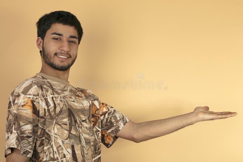 De jonge mens houdt zijn hand stand stock fotografie