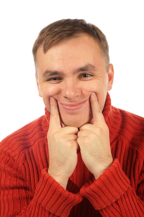 De jonge mens maakt glimlach met vingers royalty-vrije stock foto