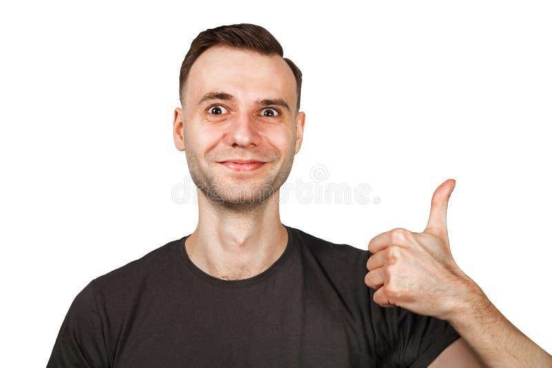 De jonge mens toont duim en glimlach Ge?soleerdj op witte achtergrond royalty-vrije stock foto
