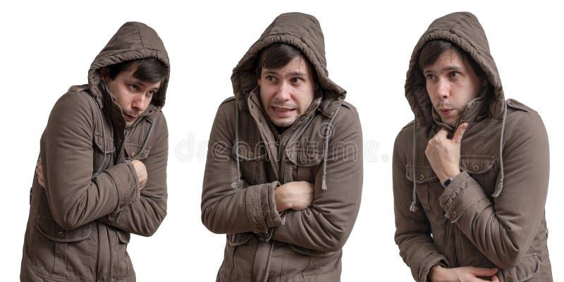 De jonge mens voelt koud Geïsoleerdj op witte achtergrond royalty-vrije stock afbeeldingen