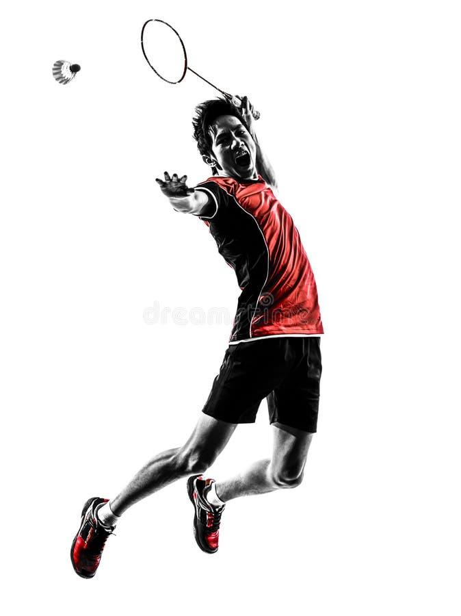 De jonge mensensilhouet van de badmintonspeler stock afbeelding