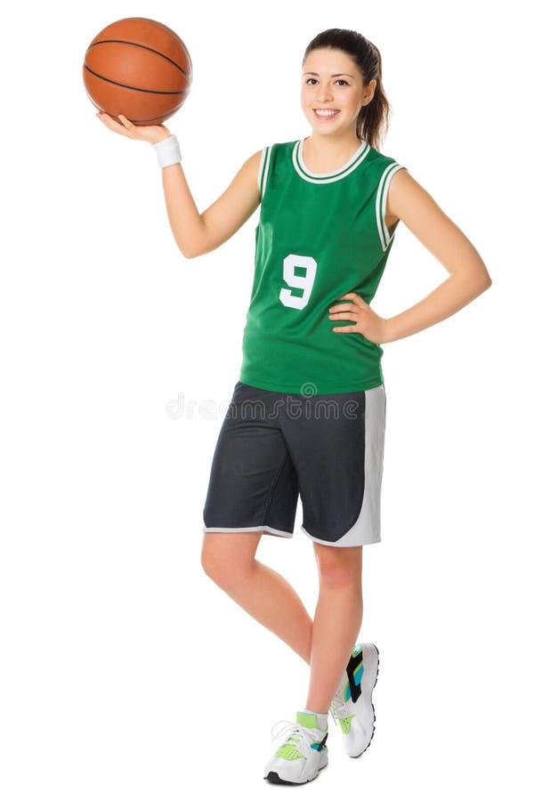 De jonge speler van het meisjesbasketbal stock foto