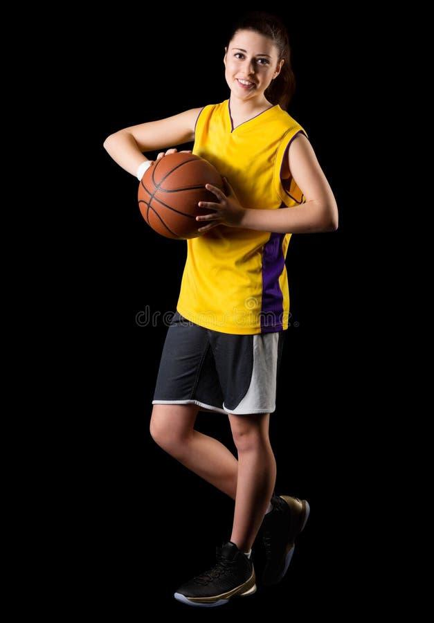 De jonge speler van het meisjesbasketbal stock fotografie