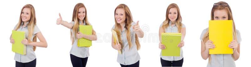 De jonge student met boeken op wit stock fotografie