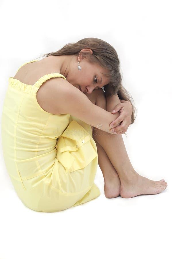 De jonge vrouw in depressie stock foto