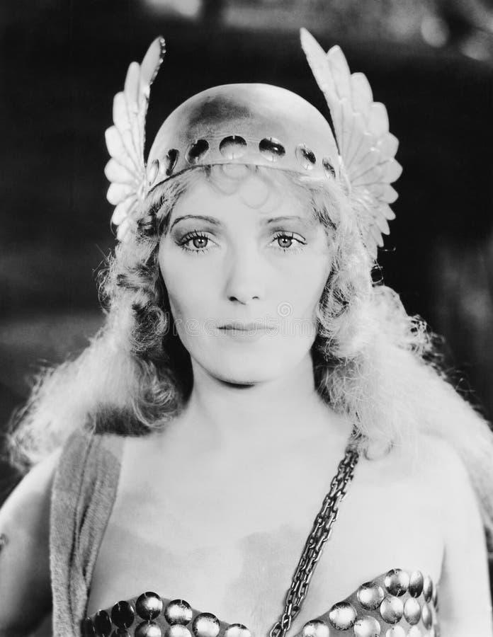 De jonge vrouw draagt haar GLB met vleugels (EV004781_H) royalty-vrije stock fotografie