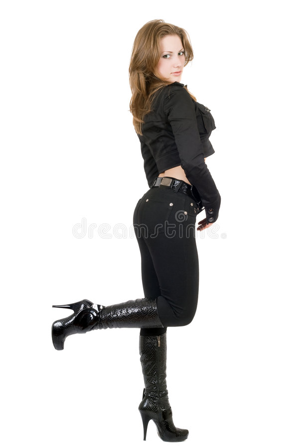 De jonge vrouw in een zwart kostuum. stock foto's