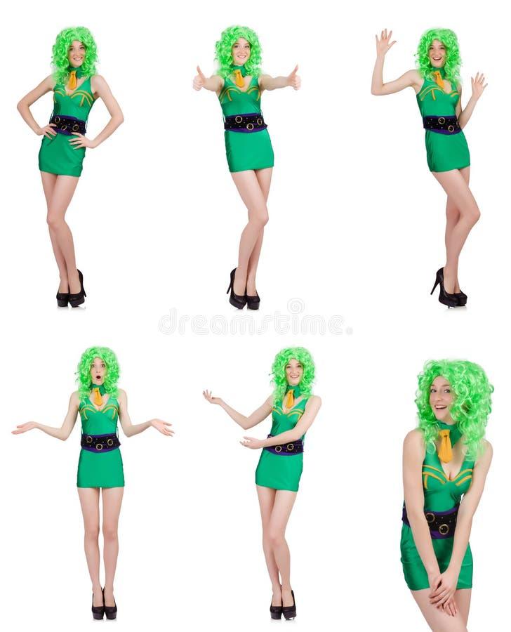 De jonge vrouw in groene minidiekleding op wit wordt geïsoleerd royalty-vrije stock afbeeldingen