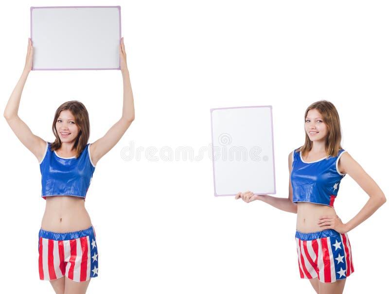 De jonge vrouw in het in dozen doen van broek die de raad houden royalty-vrije stock foto