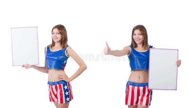 De jonge vrouw in het in dozen doen van broek die de raad houden stock foto