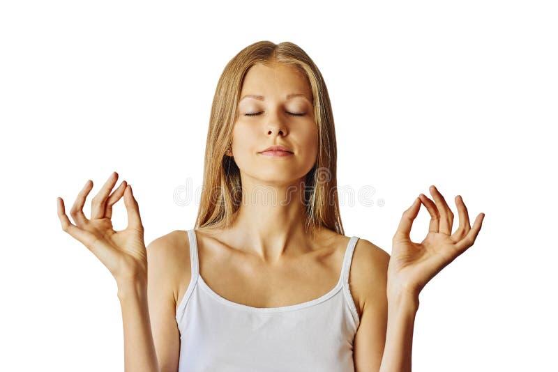 De jonge vrouw met gesloten ogen en dient lotusbloemgebaar in Meditatie, saldo en vrede van meningsconcept Ge?soleerd over wit stock foto's