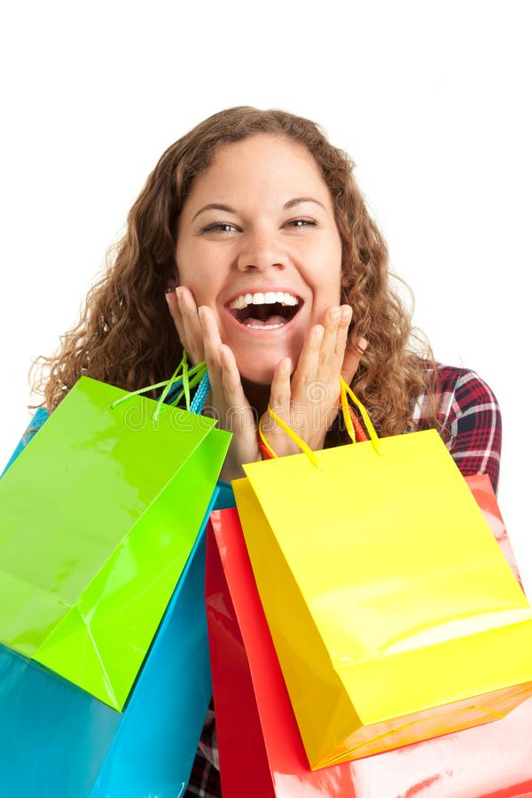 De jonge vrouw met haar kleurrijke zakken is gelukkig over het winkelen disco royalty-vrije stock afbeeldingen