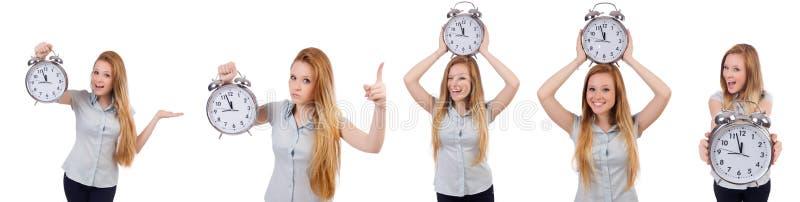 De jonge vrouw met klok op wit royalty-vrije stock afbeeldingen