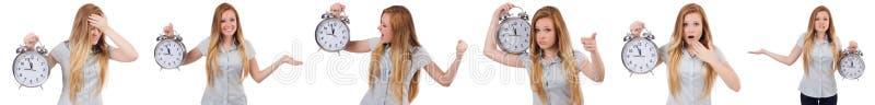 De jonge vrouw met klok op wit stock afbeelding