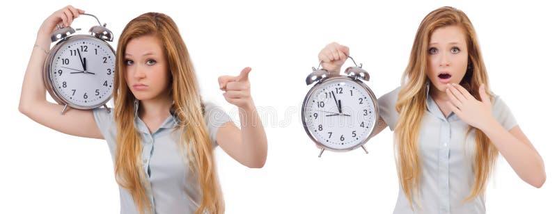 De jonge vrouw met klok op wit stock foto's