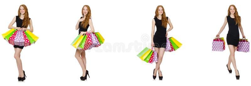 De jonge vrouw met zakken in shopaholic concept stock afbeeldingen