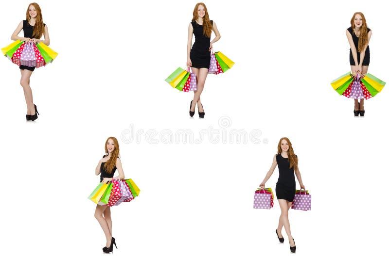 De jonge vrouw met zakken in shopaholic concept royalty-vrije stock afbeeldingen