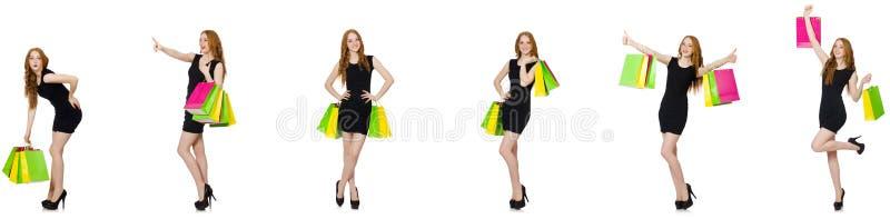 De jonge vrouw met zakken in shopaholic concept royalty-vrije stock foto