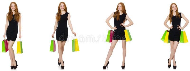 De jonge vrouw met zakken in shopaholic concept royalty-vrije stock afbeelding