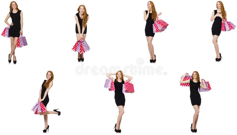 De jonge vrouw met zakken in shopaholic concept stock fotografie