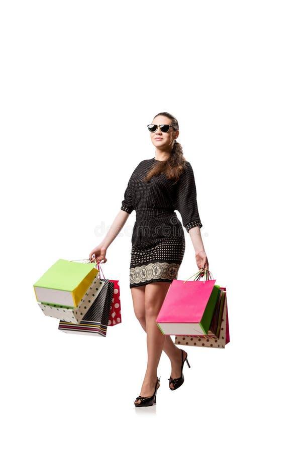 De jonge vrouw na winkelen geïsoleerd op wit royalty-vrije stock foto's