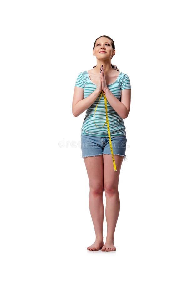 De jonge vrouw in sportenconcept dat op het wit wordt geïsoleerd stock foto