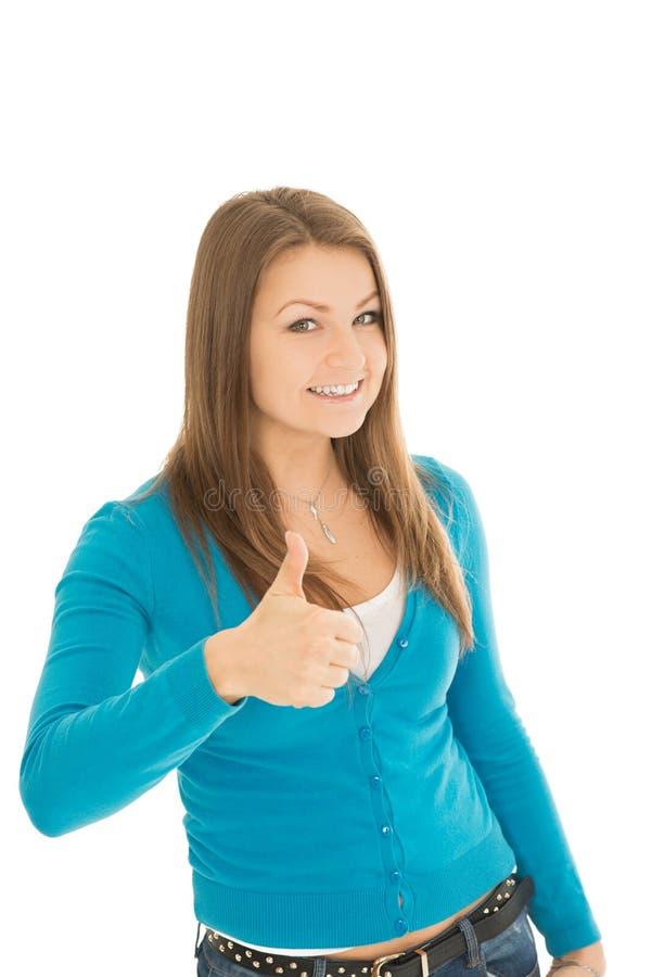 De jonge vrouw toont duim stock afbeeldingen