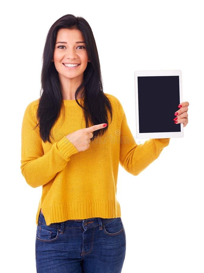 De jonge vrouw toont het aanrakingsscherm stock afbeelding