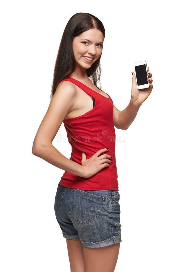 De jonge vrouw toont vertoning van mobiele celtelefoon stock afbeeldingen