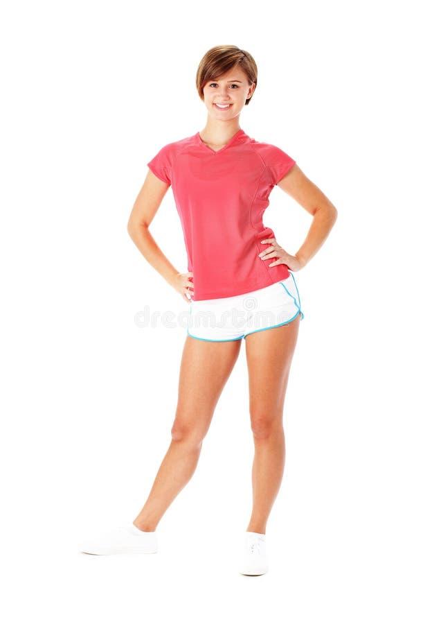 De jonge Vrouw van de Geschiktheid in Rood Overhemd die op Wit wordt geïsoleerdo stock afbeelding
