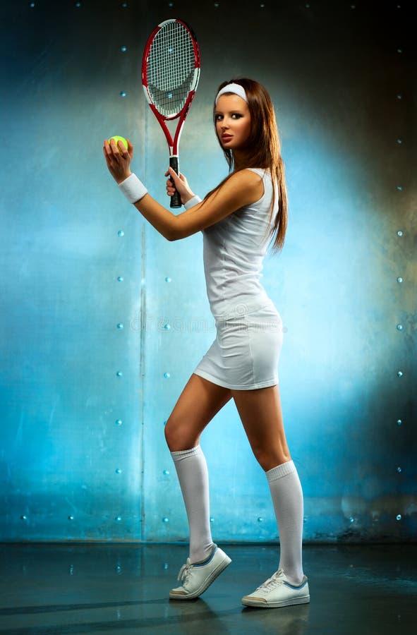 De jonge vrouw van de tennisspeler royalty-vrije stock foto's