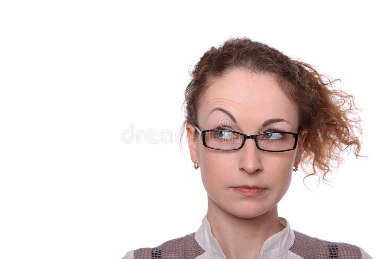 De jonge vrouw verraste scepticus kijkt stock foto