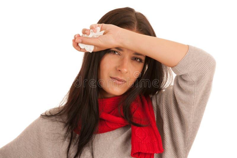 De jonge zieke die vrouw heeft hoofdpijn over witte achtergrond wordt geïsoleerd stock foto