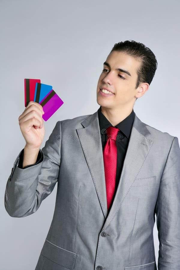 De jongelui van de zakenman met drie creditcards royalty-vrije stock foto's