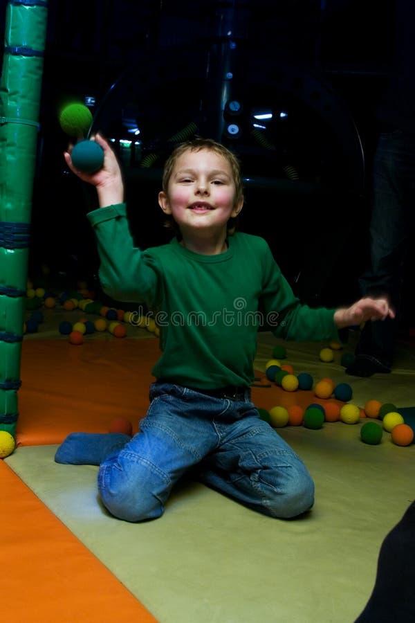 De jongen in de speelkamer royalty-vrije stock foto's