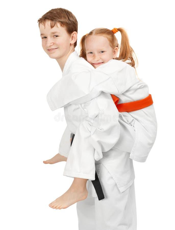 De jongen en het meisje van de karate royalty-vrije stock foto's