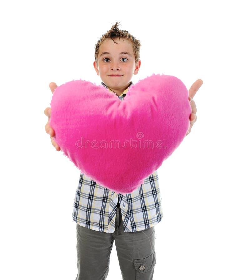 De jongen geeft een hart stock afbeeldingen