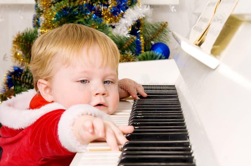 De jongen kleedde zich als Kerstman stock fotografie