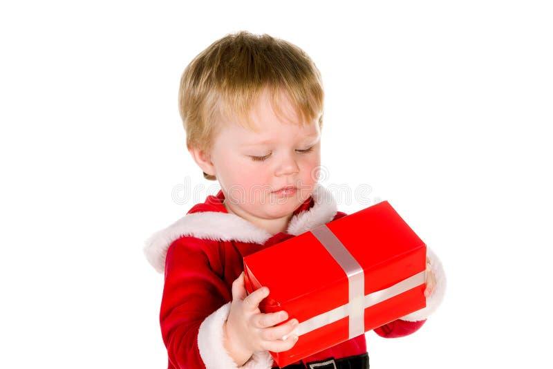 De jongen kleedde zich als Kerstman stock afbeelding