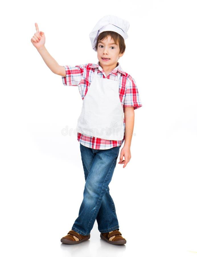 De jongen kleedde zich als kok royalty-vrije stock afbeeldingen