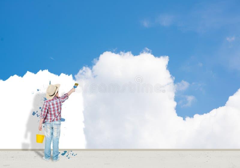 De jongen schildert de muur royalty-vrije stock foto