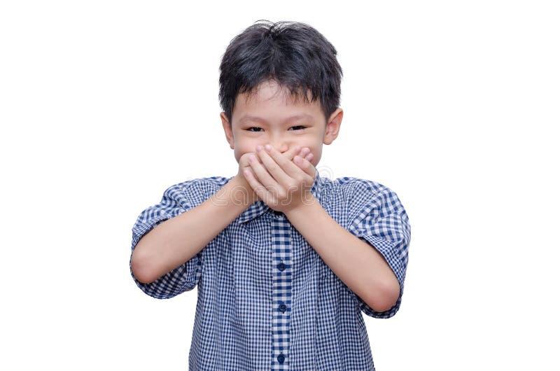 De jongen sluit zijn mond door handen royalty-vrije stock afbeeldingen