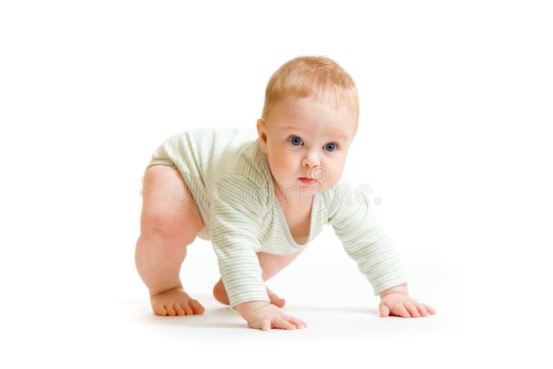 De jongen van de baby peuter het geïsoleerdew proberen op te staan royalty-vrije stock afbeelding